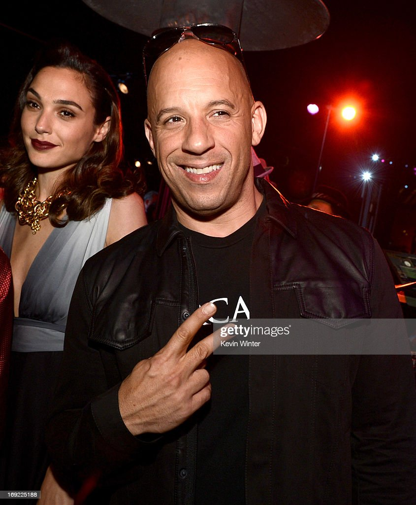 Actress Gal Gadot (L) and actor/producer Vin Diesel pose at the after party for the premiere of Universal Pictures' 'Fast & Furious 6' at the Gibson Amphitheatre on May 21, 2013 in Universal City, California.
