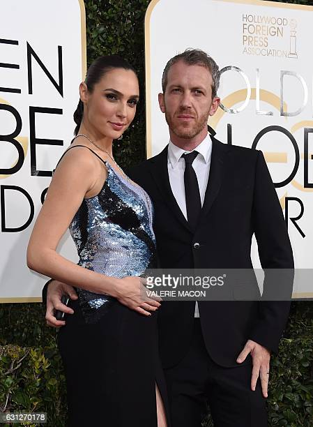 Actress Gal Gadot and husband Yaron Versano arrive at the 74th annual Golden Globe Awards January 8 at the Beverly Hilton Hotel in Beverly Hills...