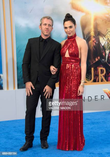 Actress Gal Gadot and husband Yaron Versano attend the world premiere of 'Wonder Woman' at the Pantages on May 25 2017 in Hollywood California / AFP...