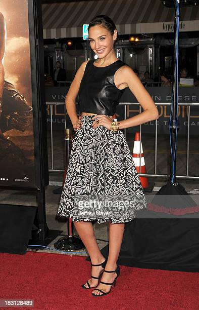 Actress Gal Gadot arrives at the Los Angeles premiere of 'Riddick' at the Westwood Village Theatre on August 28 2013 in Westwood California