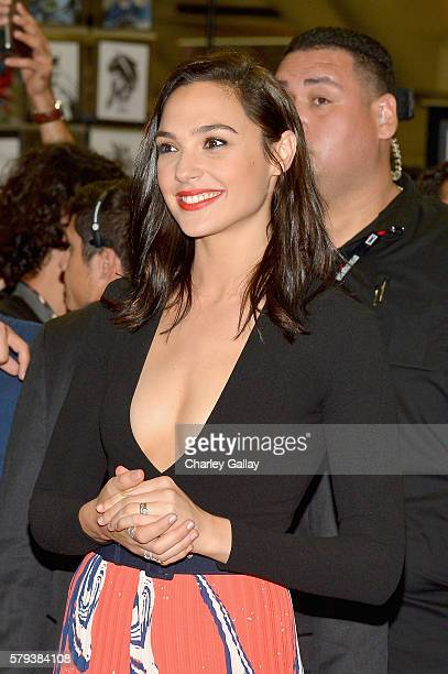 Actress Gal Gadot from the 2017 feature film Wonder Woman attend an autograph signing session for fans in DC's 2016 San Diego ComicCon booth at San...