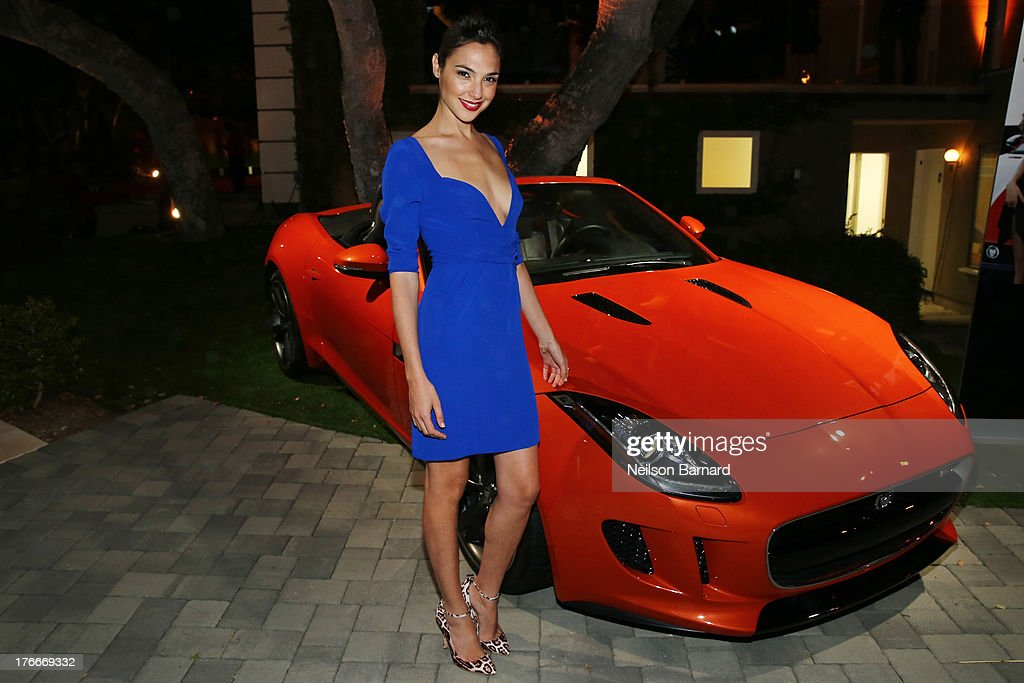Actress <a gi-track='captionPersonalityLinkClicked' href=/galleries/search?phrase=Gal+Gadot&family=editorial&specificpeople=4350069 ng-click='$event.stopPropagation()'>Gal Gadot</a> with the 2014 Jaguar F-TYPE at the Jaguar and Playboy Magazine exclusive VIP reception to celebrate Jaguar's high-performance models during Pebble Beach weekend on August 16, 2013 in Monterey, California.
