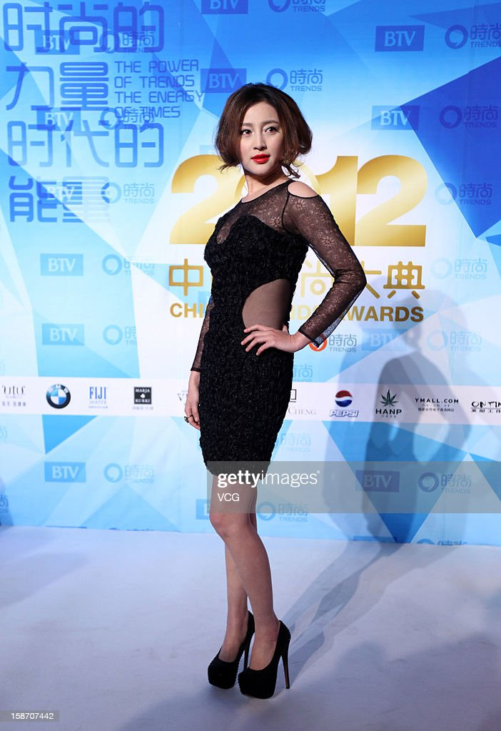Actress Gan Tingting arrives at the red carpet of the 2012 China Trends Awards at BTV Grand Theater on December 22, 2012 in Beijing, China.