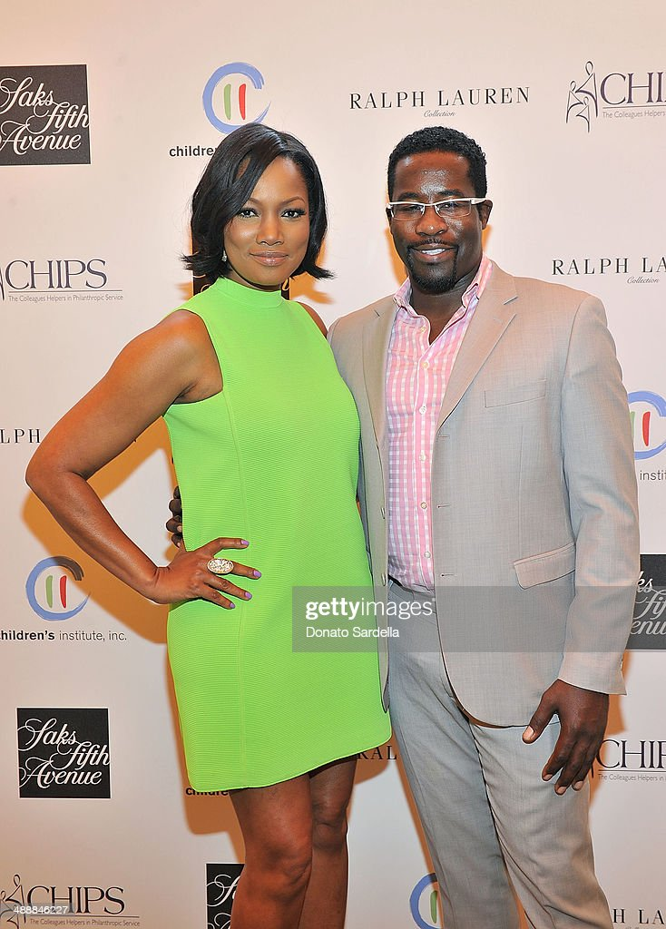 Actress <a gi-track='captionPersonalityLinkClicked' href=/galleries/search?phrase=Garcelle+Beauvais&family=editorial&specificpeople=203112 ng-click='$event.stopPropagation()'>Garcelle Beauvais</a> and Daniel Beaty attend C.H.I.P.S Colleagues Helpers in Philanthropic Service Children's Institute annual charity luncheon at The Four Seasons Hotel on May 8, 2014 in Beverly Hills, California.