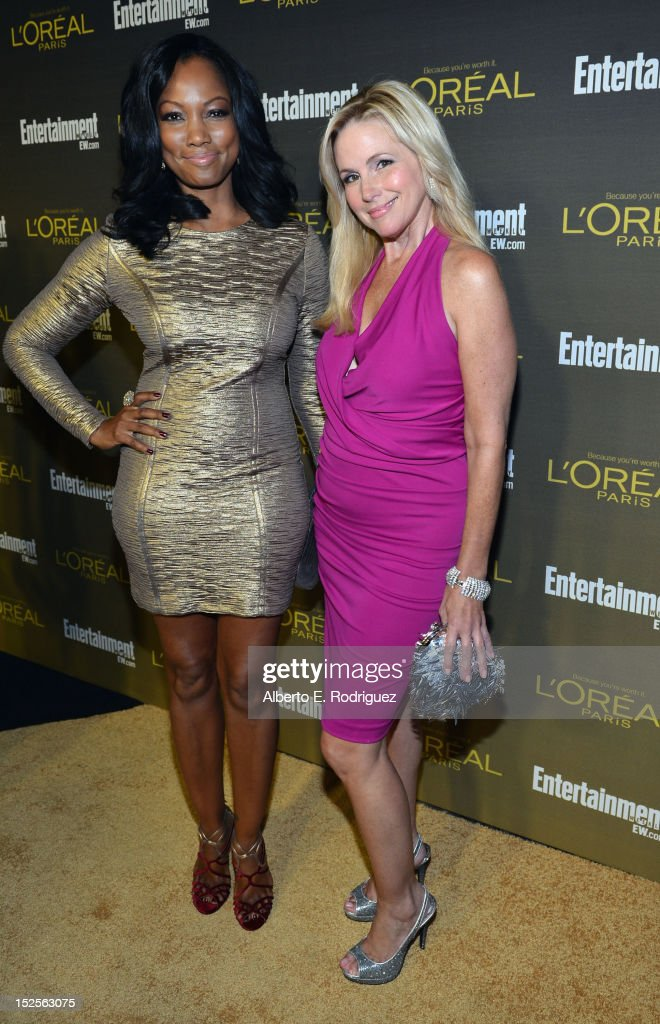 Actress Garcelle Beauvais and guest attend The 2012 Entertainment Weekly Pre-Emmy Party Presented By L'Oreal Paris at Fig & Olive Melrose Place on September 21, 2012 in West Hollywood, California.