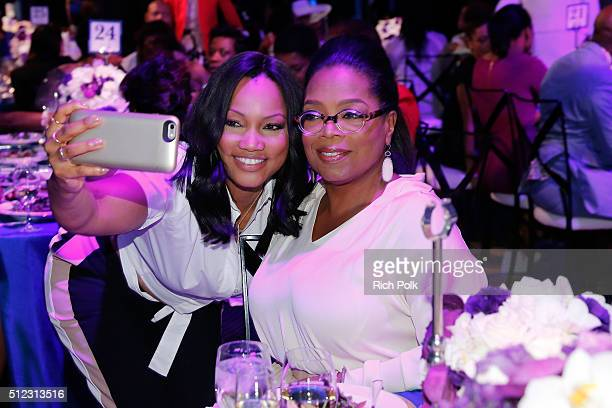 Actress Garcelle Beauvais and Oprah Winfrey attends the 2016 ESSENCE Black Women In Hollywood awards luncheon at the Beverly Wilshire Four Seasons...