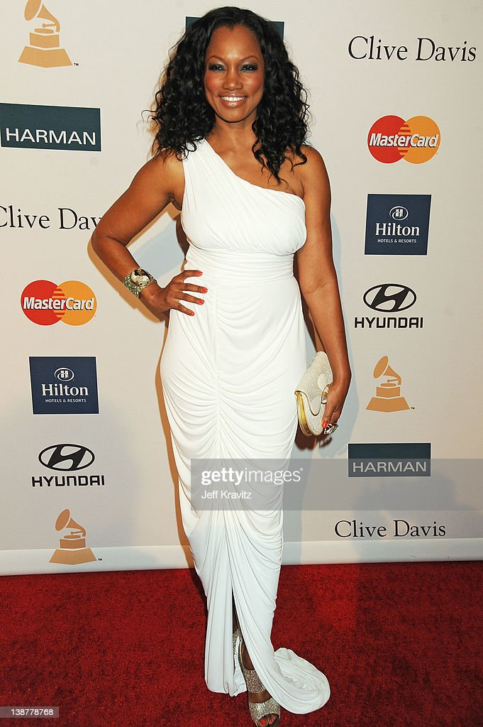 Actress <a gi-track='captionPersonalityLinkClicked' href=/galleries/search?phrase=Garcelle+Beauvais&family=editorial&specificpeople=203112 ng-click='$event.stopPropagation()'>Garcelle Beauvais</a> arrives at Clive Davis and the Recording Academy's 2012 Pre-GRAMMY Gala and Salute to Industry Icons Honoring Richard Branson held at The Beverly Hilton Hotel on February 11, 2012 in Beverly Hills, California.