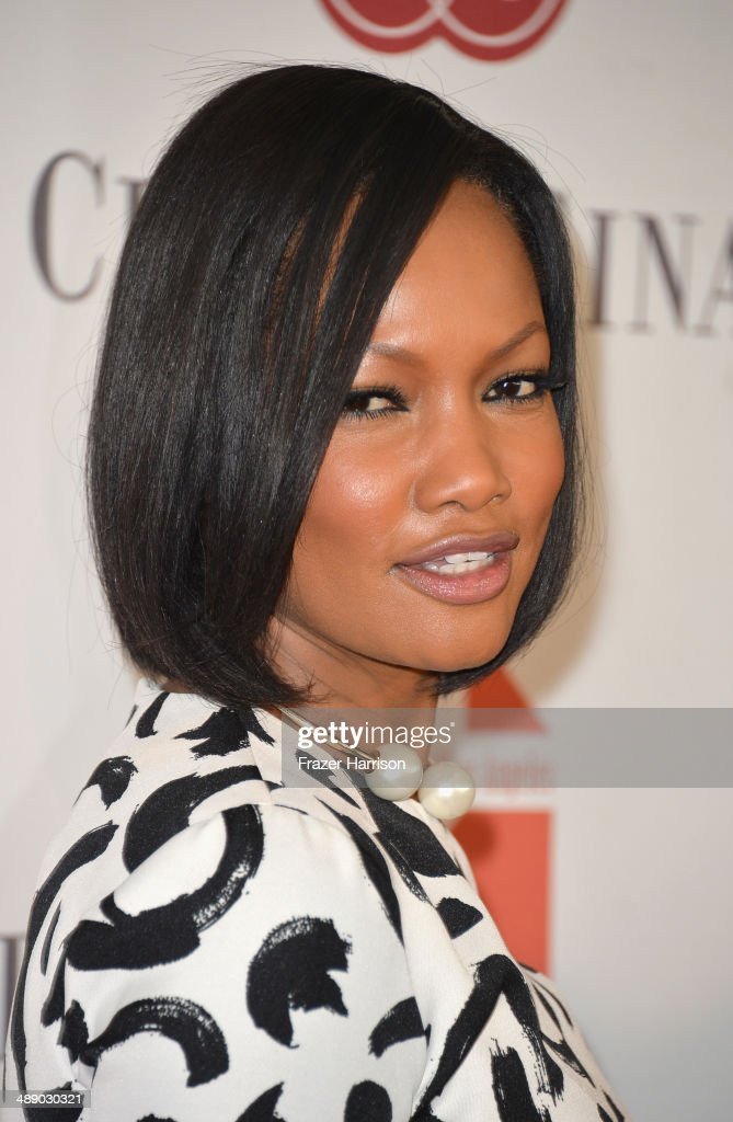 Actress <a gi-track='captionPersonalityLinkClicked' href=/galleries/search?phrase=Garcelle+Beauvais&family=editorial&specificpeople=203112 ng-click='$event.stopPropagation()'>Garcelle Beauvais</a> arrives at The Helping Hand of Los Angeles Mother's Day Luncheon at The Beverly Hilton Hotel on May 9, 2014 in Beverly Hills, California.