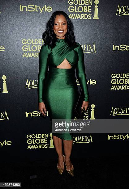 Actress Garcelle Beauvais arrives at The Hollywood Foreign Press Association and InStyle's 2015 Golden Globe Award Season celebration at Fig Olive...