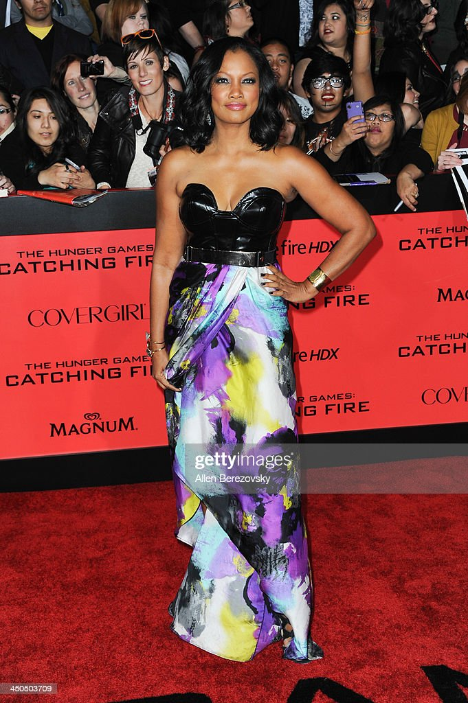 Actress Garcelle Beauvais arrives at the Los Angeles Premiere of 'The Hunger Games: Catching Fire' at Nokia Theatre L.A. Live on November 18, 2013 in Los Angeles, California.