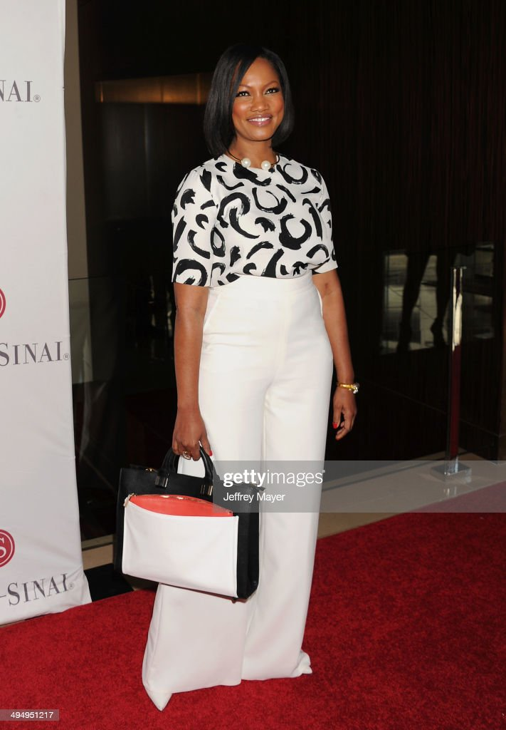 Actress Garcelle Beauvais arrives at the The Helping Hand Of Los Angeles Mother's Day Luncheon at The Beverly Hilton Hotel on May 9, 2014 in Beverly Hills, California.