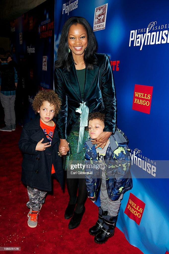 Actress <a gi-track='captionPersonalityLinkClicked' href=/galleries/search?phrase=Garcelle+Beauvais&family=editorial&specificpeople=203112 ng-click='$event.stopPropagation()'>Garcelle Beauvais</a> attends 'A Snow White Christmas' with her two sons at the Pasadena Playhouse on December 12, 2012 in Pasadena, California.
