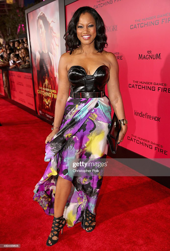 Actress <a gi-track='captionPersonalityLinkClicked' href=/galleries/search?phrase=Garcelle+Beauvais&family=editorial&specificpeople=203112 ng-click='$event.stopPropagation()'>Garcelle Beauvais</a> attends premiere of Lionsgate's 'The Hunger Games: Catching Fire' - Red Carpet at Nokia Theatre L.A. Live on November 18, 2013 in Los Angeles, California.