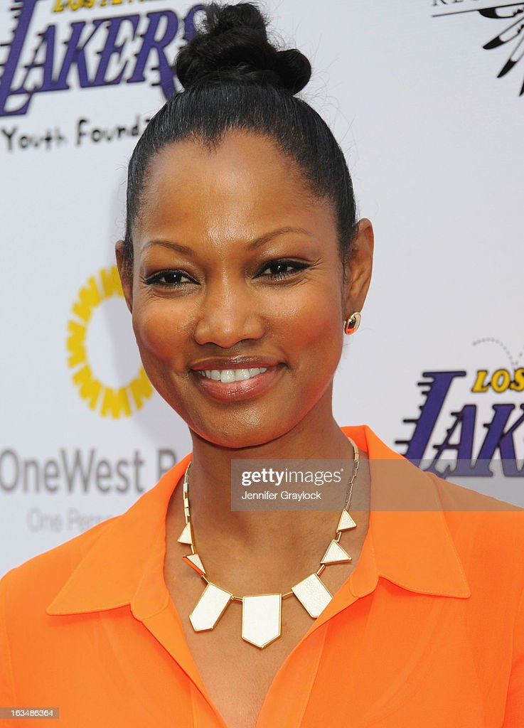 Actress <a gi-track='captionPersonalityLinkClicked' href=/galleries/search?phrase=Garcelle+Beauvais&family=editorial&specificpeople=203112 ng-click='$event.stopPropagation()'>Garcelle Beauvais</a> attends the Lakers Casino Night held at Club Nokia on March 10, 2013 in Los Angeles, California.