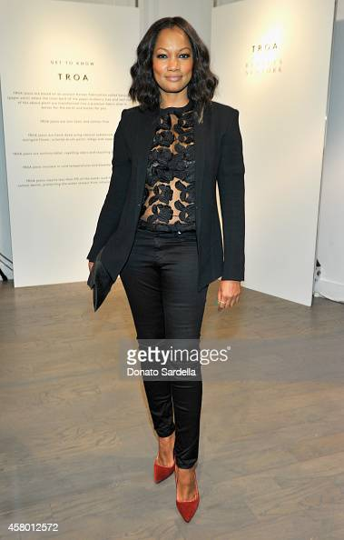 Actress Garcelle Beauvais attends the TROA denim event at Barneys in Los Angeles on October 28 2014 in Los Angeles California