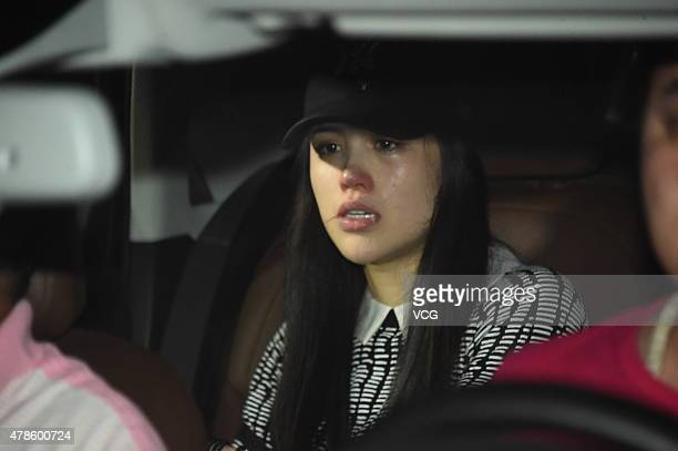 Actress Ge Tian exwife of retired Chinese hurdler Liu Xiang cries as she taking a car leaves the Beijing Capital International Airport after divorce...