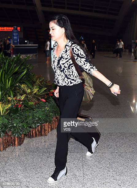 Actress Ge Tian exwife of retired Chinese hurdler Liu Xiang cries as she walks at the terminal of the Beijing Capital International Airport after...