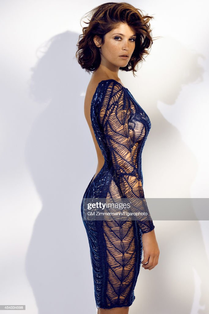 110258-011. Actress <a gi-track='captionPersonalityLinkClicked' href=/galleries/search?phrase=Gemma+Arterton&family=editorial&specificpeople=4296305 ng-click='$event.stopPropagation()'>Gemma Arterton</a> is photographed for Madame Figaro on June 19, 2014 in Paris, France. Dress (Julien MacDonald), earrings (Dior). Make-up by Sisley.