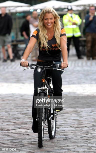 Actress Gemma Atkinson riding a mountain bike in Covent Garden central London where Orange gave away hundreds of the bike to celebrate the 2007 Tour...