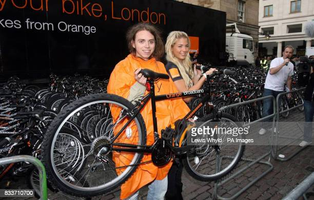 Actress Gemma Atkinson with a lucky customer in Covent Garden central London where Orange gave away hundreds of mountain bikes to celebrate the 2007...