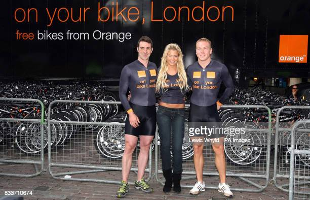 Actress Gemma Atkinson with GB Olympic cycling gold medallists Chris Hoy and Jason Queally in Covent Garden central London where Orange gave away...