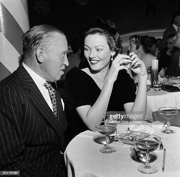 Actress Gene Tierney and guest attend the premiere party for 'Red Garters' in Los AngelesCA