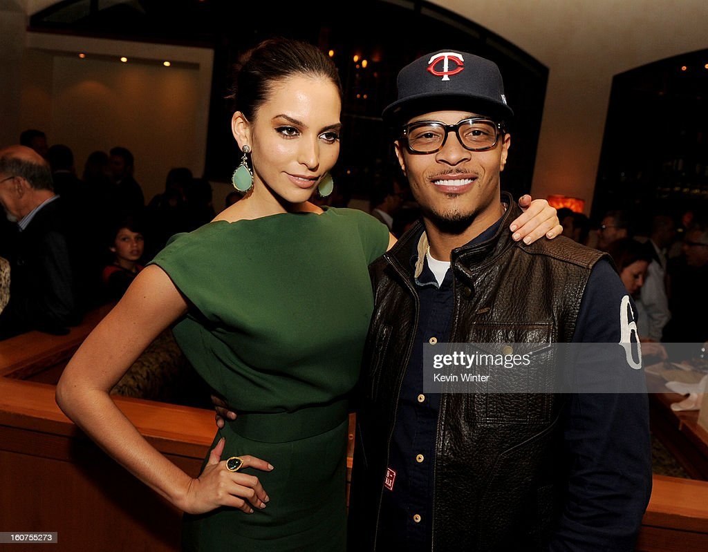 Actress <a gi-track='captionPersonalityLinkClicked' href=/galleries/search?phrase=Genesis+Rodriguez&family=editorial&specificpeople=220790 ng-click='$event.stopPropagation()'>Genesis Rodriguez</a> (L) and actor/rapper T.I. pose at the after party for the premiere of Universal Pictures' 'Identity Thief' at Napa Valley Grille on February 4, 2013 in Los Angeles, California.