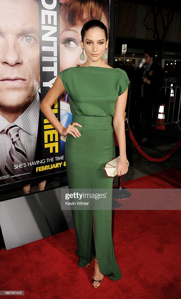 Actress Genesis Rodriguez arrives at the premiere of Universal Pictures' 'Identity Thief' at the Village Theatre on February 4, 2013 in Los Angeles, California.