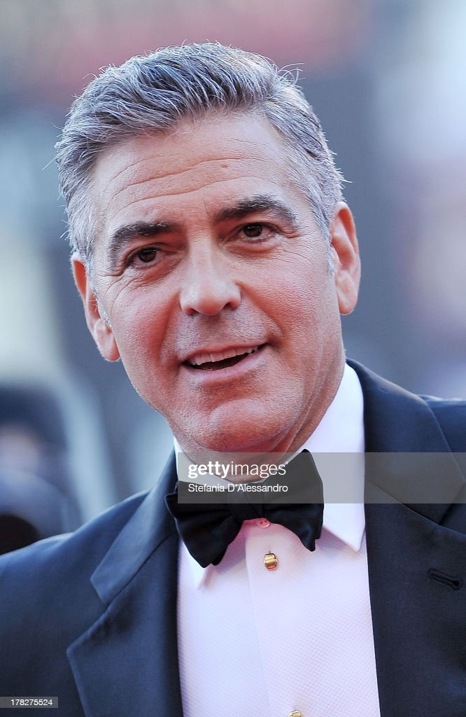 Actress <a gi-track='captionPersonalityLinkClicked' href=/galleries/search?phrase=George+Clooney&family=editorial&specificpeople=202529 ng-click='$event.stopPropagation()'>George Clooney</a> attends 'Gravity' premiere and Opening Ceremony during The 70th Venice International Film Festival at Sala Grande on August 28, 2013 in Venice, Italy.