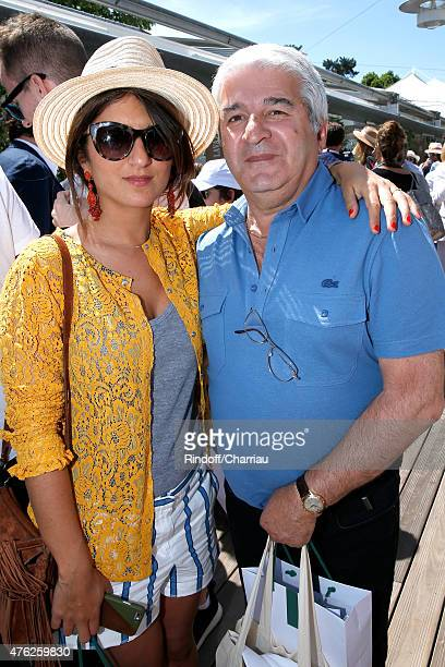 Actress Geraldine Nakache and her father attend the Men Final of 2015 Roland Garros French Tennis Open Day Fithteen on June 7 2015 in Paris France
