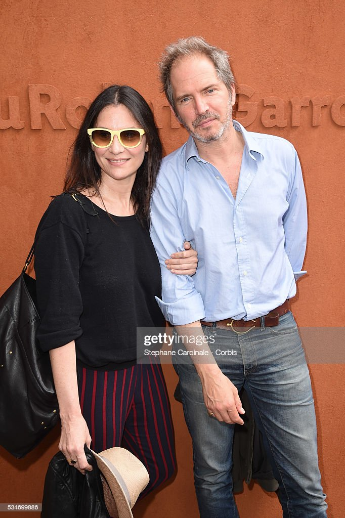 Actress <a gi-track='captionPersonalityLinkClicked' href=/galleries/search?phrase=Geraldine+Pailhas&family=editorial&specificpeople=2444310 ng-click='$event.stopPropagation()'>Geraldine Pailhas</a> and her husband Christopher Thompson attend day six of the 2016 French Open at Roland Garros on May 27, 2016 in Paris, France.