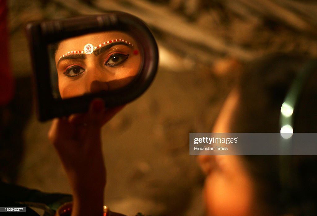 Actress get ready backstage for a performance of the Ramlila on October 7, 2013 in Jammu, India. Ramlila is a dramatic folk re-enactment of the life of Hindu Lord Rama's victory after a ten day battle with the ten headed Demon King Ravana.