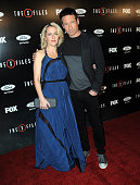 Actress Gillian Anderson and actor David Duchovny arrive for the premiere of Fox's 'The XFiles' held at California Science Center on January 12 2016...