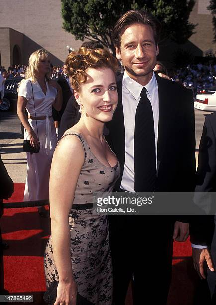 Actress Gillian Anderson and actor David Duchovny attend the 48th Annual Primetime Emmy Awards on September 8 1996 at the Pasadena Civic Auditorium...