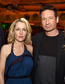 Actress Gillian Anderson and actor David Duchovny pose at the after party for the premiere of Fox's 'The XFiles' at the California Science Center on...