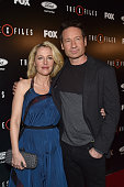 Actress Gillian Anderson and David Duchovny attend the premiere of Fox's 'The XFiles' at California Science Center on January 12 2016 in Los Angeles...