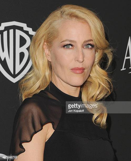 Actress Gillian Anderson arrives at the 16th Annual Warner Bros And InStyle PostGolden Globe Party at The Beverly Hilton Hotel on January 11 2015 in...