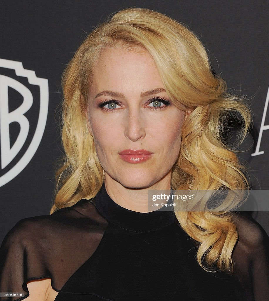 Actress <a gi-track='captionPersonalityLinkClicked' href=/galleries/search?phrase=Gillian+Anderson&family=editorial&specificpeople=202894 ng-click='$event.stopPropagation()'>Gillian Anderson</a> arrives at the 16th Annual Warner Bros. And InStyle Post-Golden Globe Party at The Beverly Hilton Hotel on January 11, 2015 in Beverly Hills, California.
