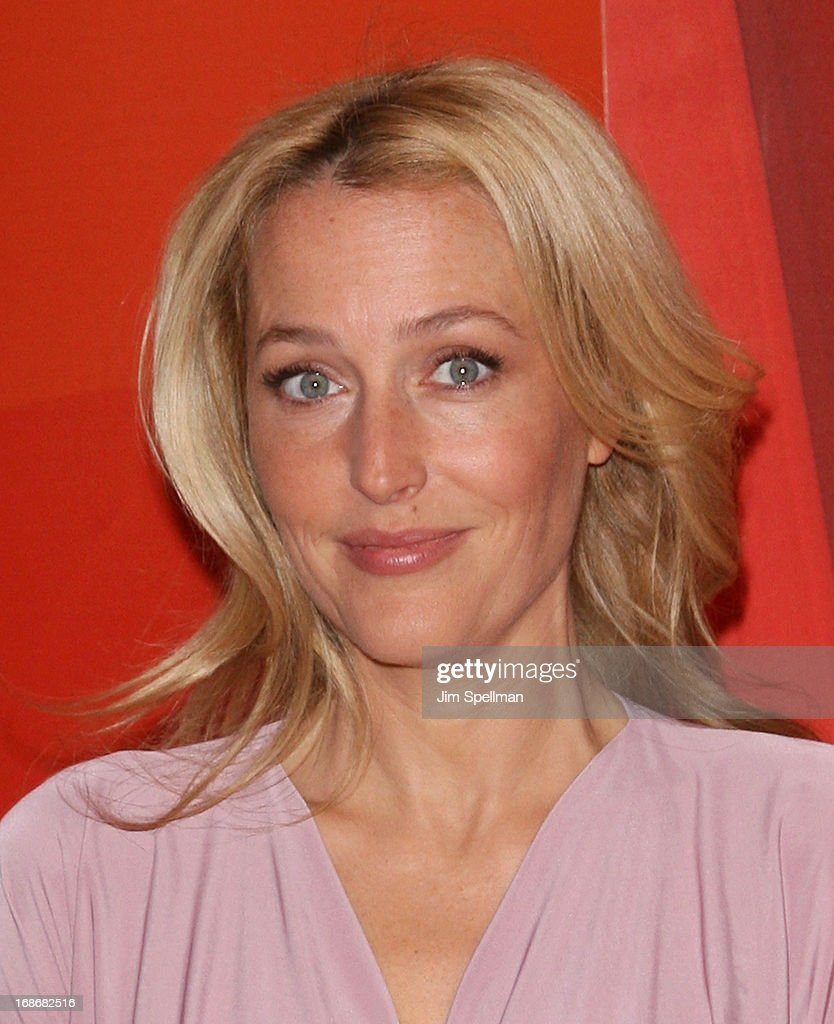Actress <a gi-track='captionPersonalityLinkClicked' href=/galleries/search?phrase=Gillian+Anderson&family=editorial&specificpeople=202894 ng-click='$event.stopPropagation()'>Gillian Anderson</a> attends 2013 NBC Upfront Presentation Red Carpet Event at Radio City Music Hall on May 13, 2013 in New York City.