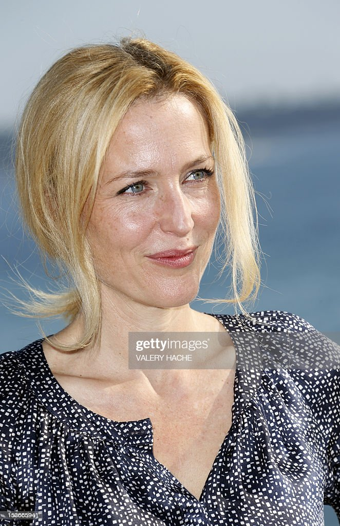 US actress Gillian Anderson poses during a photocall for a TV show 'The Fall' as part of the Mipcom international audiovisual trade show at the Palais des Festivals, in Cannes, southeastern France, on October 8, 2012.