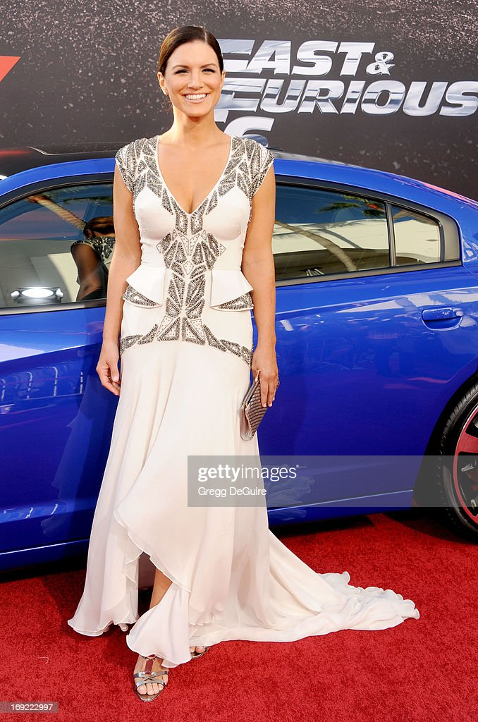 Actress Gina Carano arrives at the Los Angeles premiere of 'Fast & The Furious 6' at Gibson Amphitheatre on May 21, 2013 in Universal City, California.