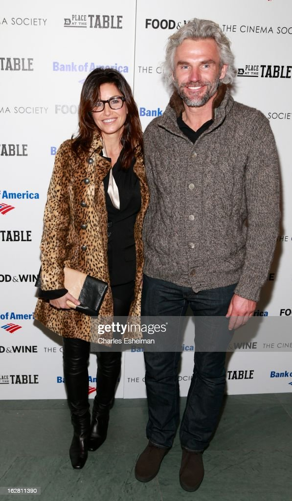 Actress Gina Gershon and entrepreneur Bobby Dekeyser arrive at Bank of America and Food & Wine with The Cinema Society present a screening of 'A Place at the Table' at the Celeste Bartos Theater at the Museum of Modern Art on February 27, 2013 in New York City.