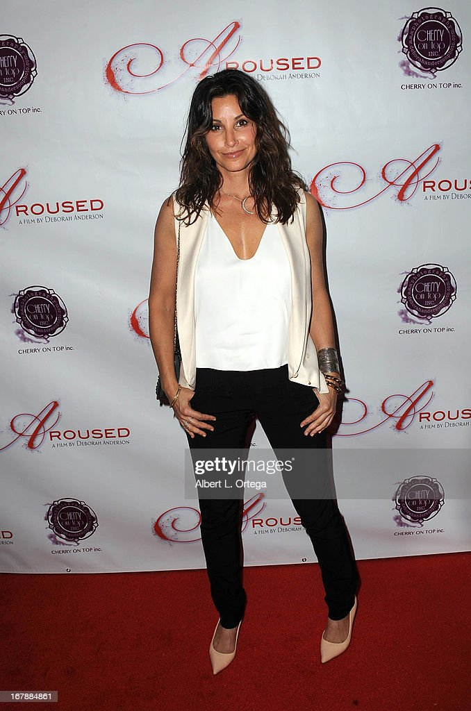 Actress Gina Gershon arrives for the Premiere Of 'Aroused' held at Landmark Nuart Theatre on May 1, 2013 in Los Angeles, California.