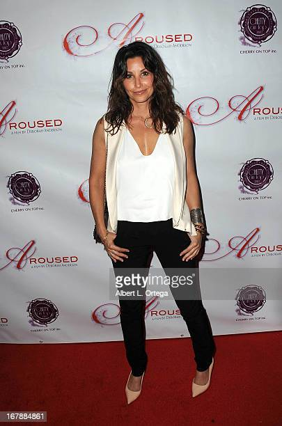 Actress Gina Gershon arrives for the Premiere Of 'Aroused' held at Landmark Nuart Theatre on May 1 2013 in Los Angeles California
