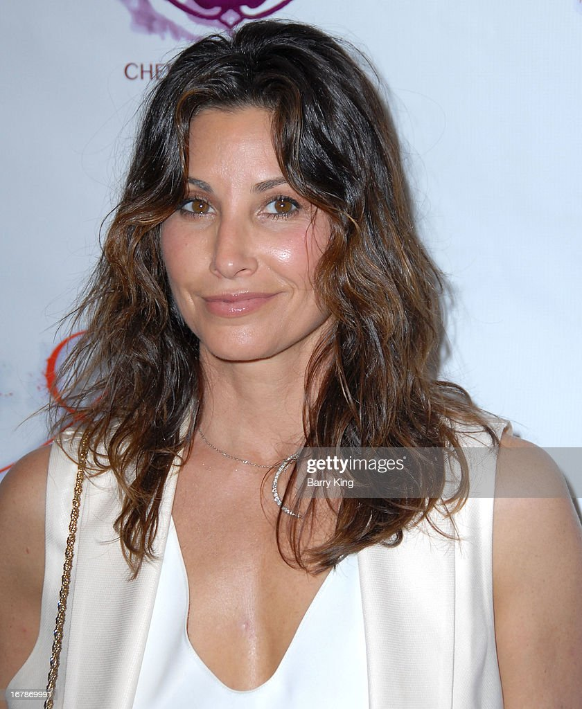 Actress <a gi-track='captionPersonalityLinkClicked' href=/galleries/search?phrase=Gina+Gershon&family=editorial&specificpeople=203099 ng-click='$event.stopPropagation()'>Gina Gershon</a> attends the 'Aroused' - Los Angeles Premiere on May 1, 2013 at the Landmark Nuart Theatre in Los Angeles, California.