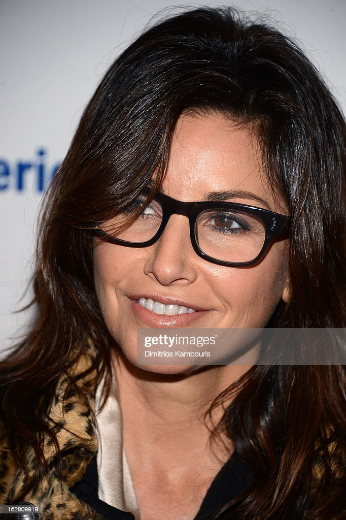 Actress Gina Gershon attends the Bank of America and Food Wine with The Cinema Society screening of 'A Place at the Table' at Museum of Modern Art on...