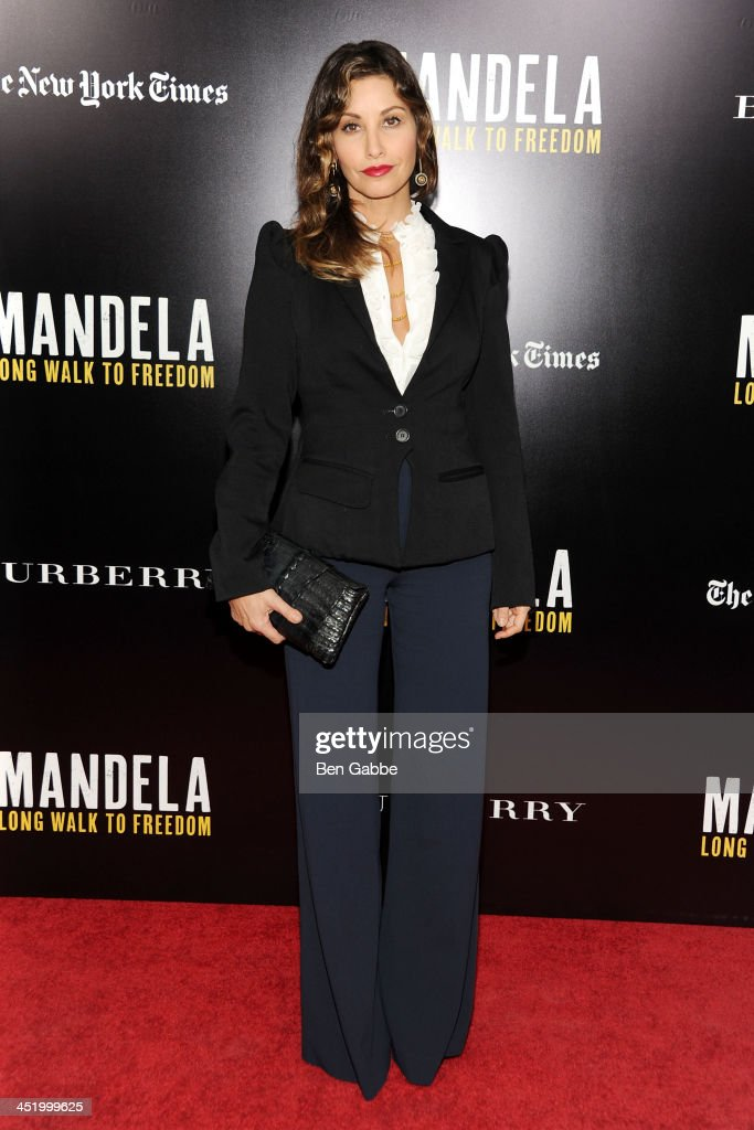 Actress <a gi-track='captionPersonalityLinkClicked' href=/galleries/search?phrase=Gina+Gershon&family=editorial&specificpeople=203099 ng-click='$event.stopPropagation()'>Gina Gershon</a> attends the screening of 'Mandela: Long Walk to Freedom', hosted by U2, Anna Wintour and Bob & Harvey Weinstein, with Burberry at the Ziegfeld Theater on November 25, 2013 in New York City.