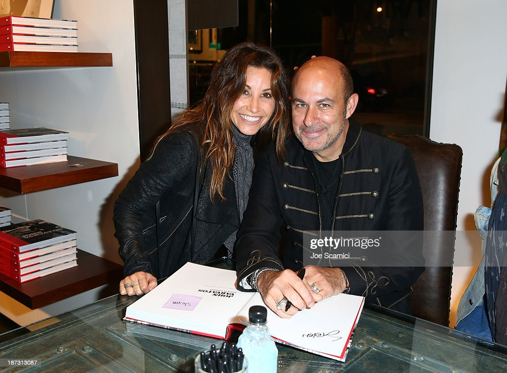 Actress Gina Gershon (L); designer/author John Varvatos (R) attend the 'John Varvatos: Rock In Fashion' book launch celebration held at John Varvatos Los Angeles on November 7, 2013 in Los Angeles, California.