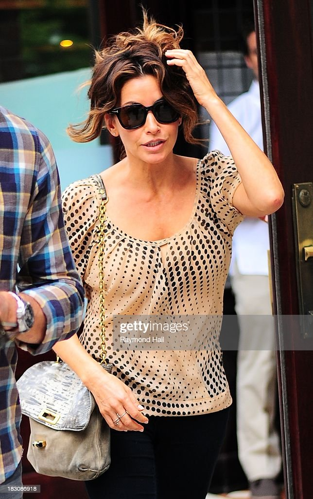 Actress <a gi-track='captionPersonalityLinkClicked' href=/galleries/search?phrase=Gina+Gershon&family=editorial&specificpeople=203099 ng-click='$event.stopPropagation()'>Gina Gershon</a> is seen in Soho on October 3, 2013 in New York City.
