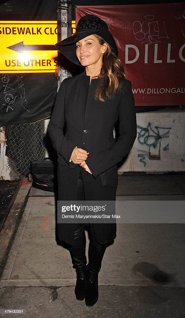 Actress <a gi-track='captionPersonalityLinkClicked' href=/galleries/search?phrase=Gina+Gershon&family=editorial&specificpeople=203099 ng-click='$event.stopPropagation()'>Gina Gershon</a> is seen on March 11, 2014 in New York City.